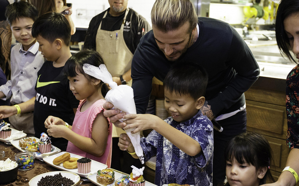 David Beckham interacted with the kids at the pastry-making workshop.