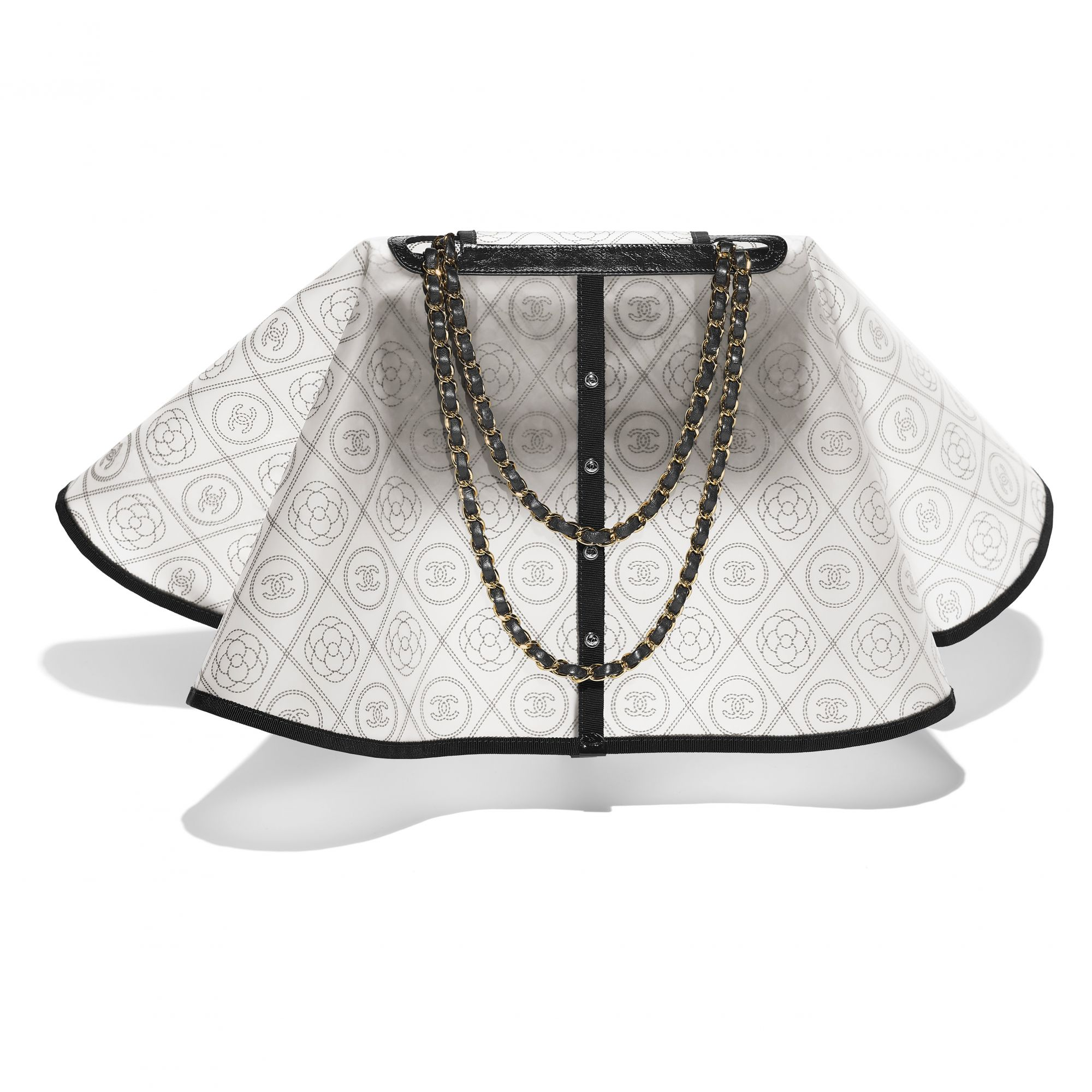 Black and white bag in printed PVC, grosgrain and leather