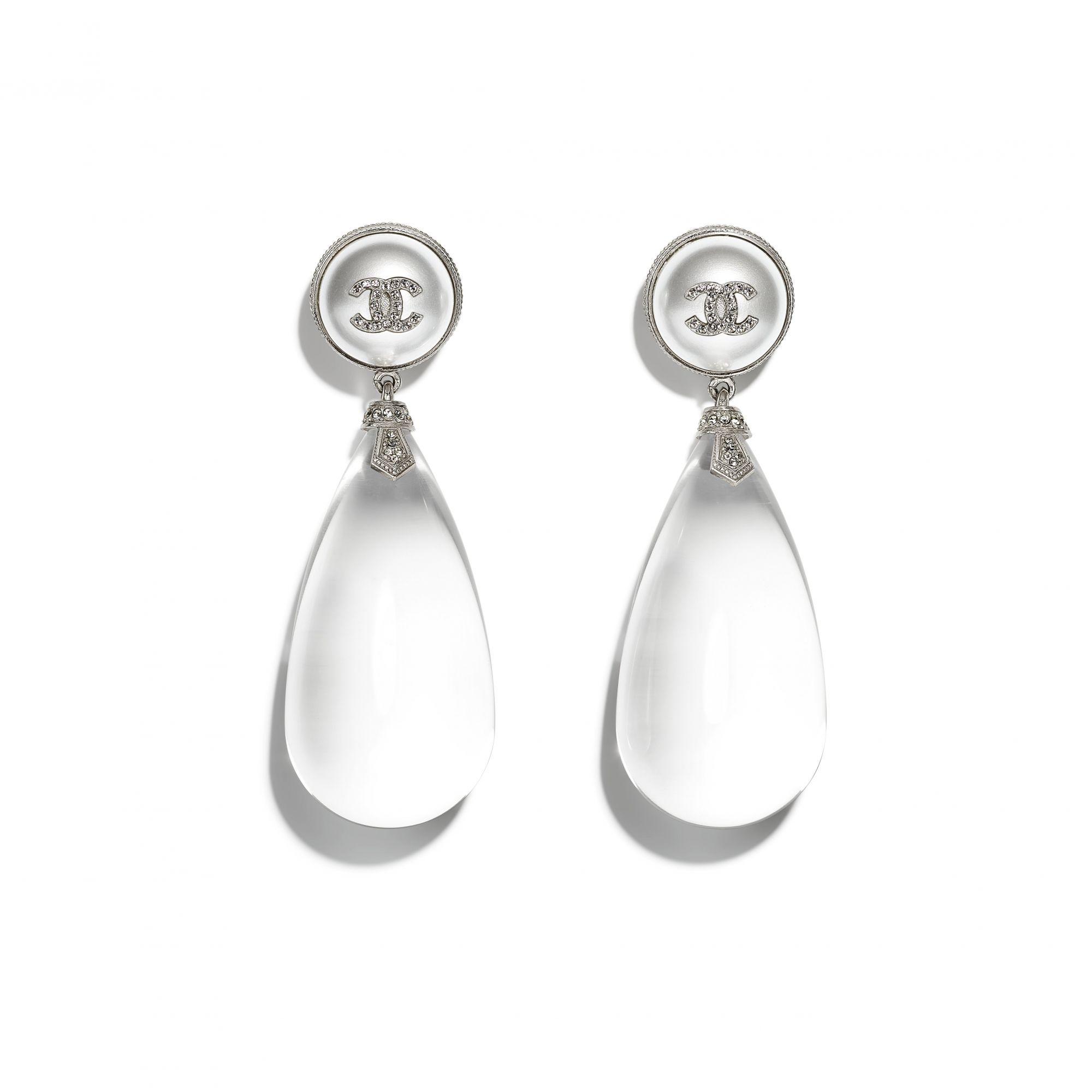 Earrings in resin, metal and strass