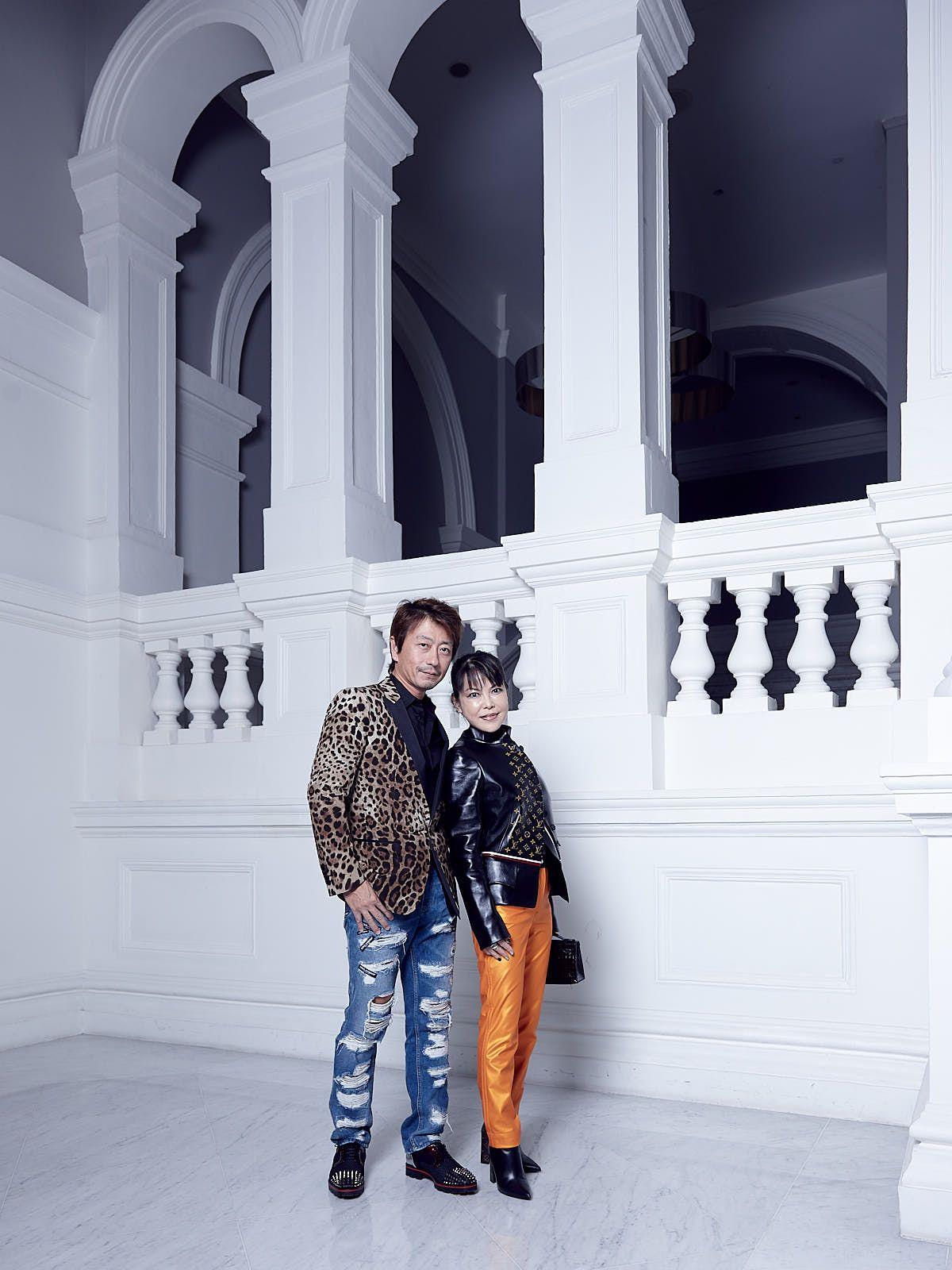 Kimihisa Abe in Dolce & Gabbana, Kyoko Abe in Louis Vuitton