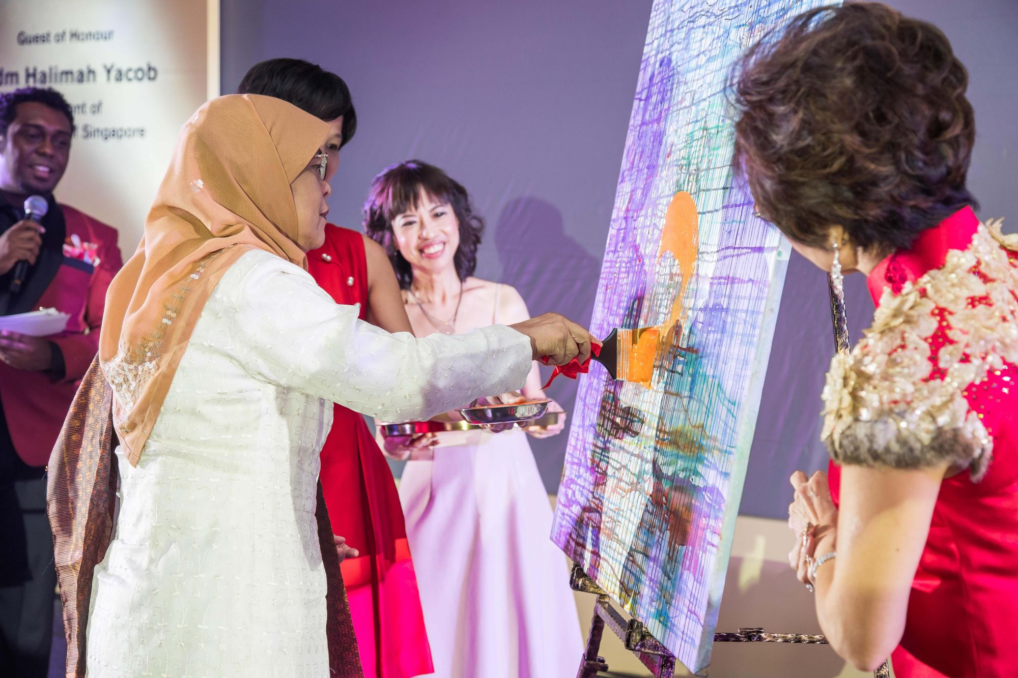 To commemorate Nafa's 80th anniversary, guest of honour, president Halimah Yacob, put the finishing touches to Singapore artist Yoko Choi's artwork titled Flowing