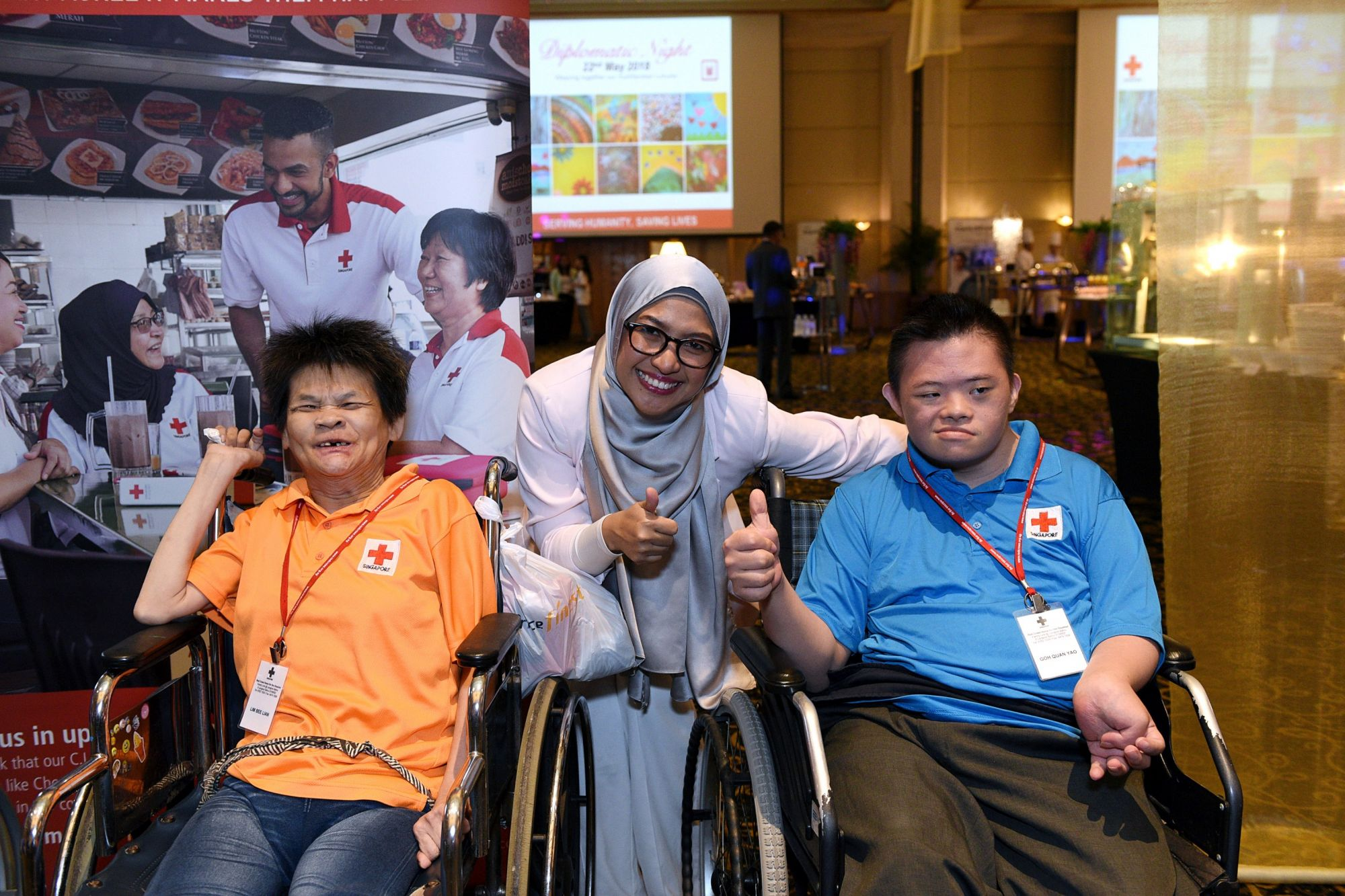 Residents of Red Cross Home for the Disabled with their caregiver