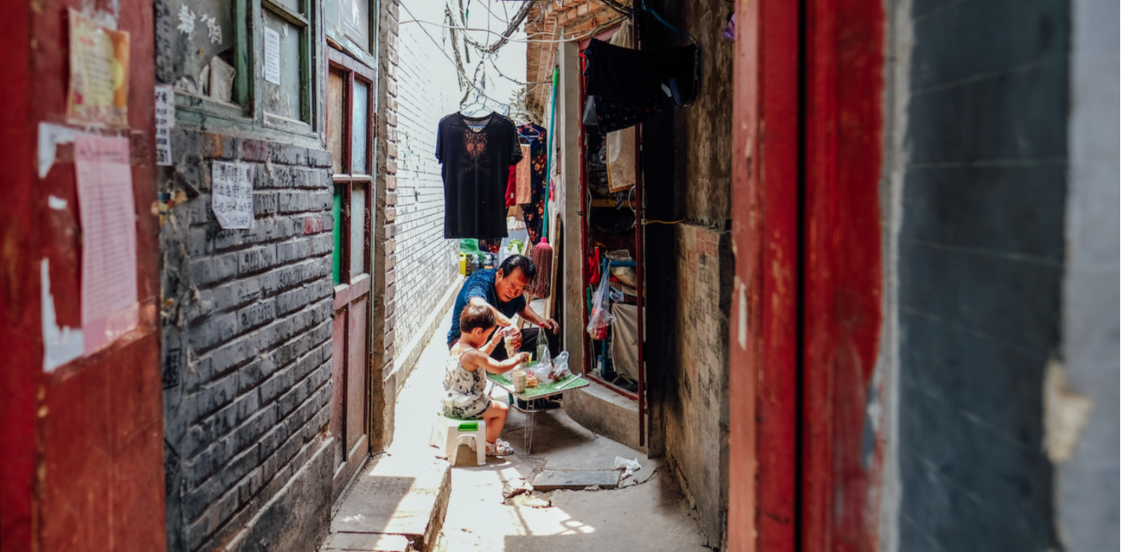 Enjoying Lunchtime with grandpa in a Hutong