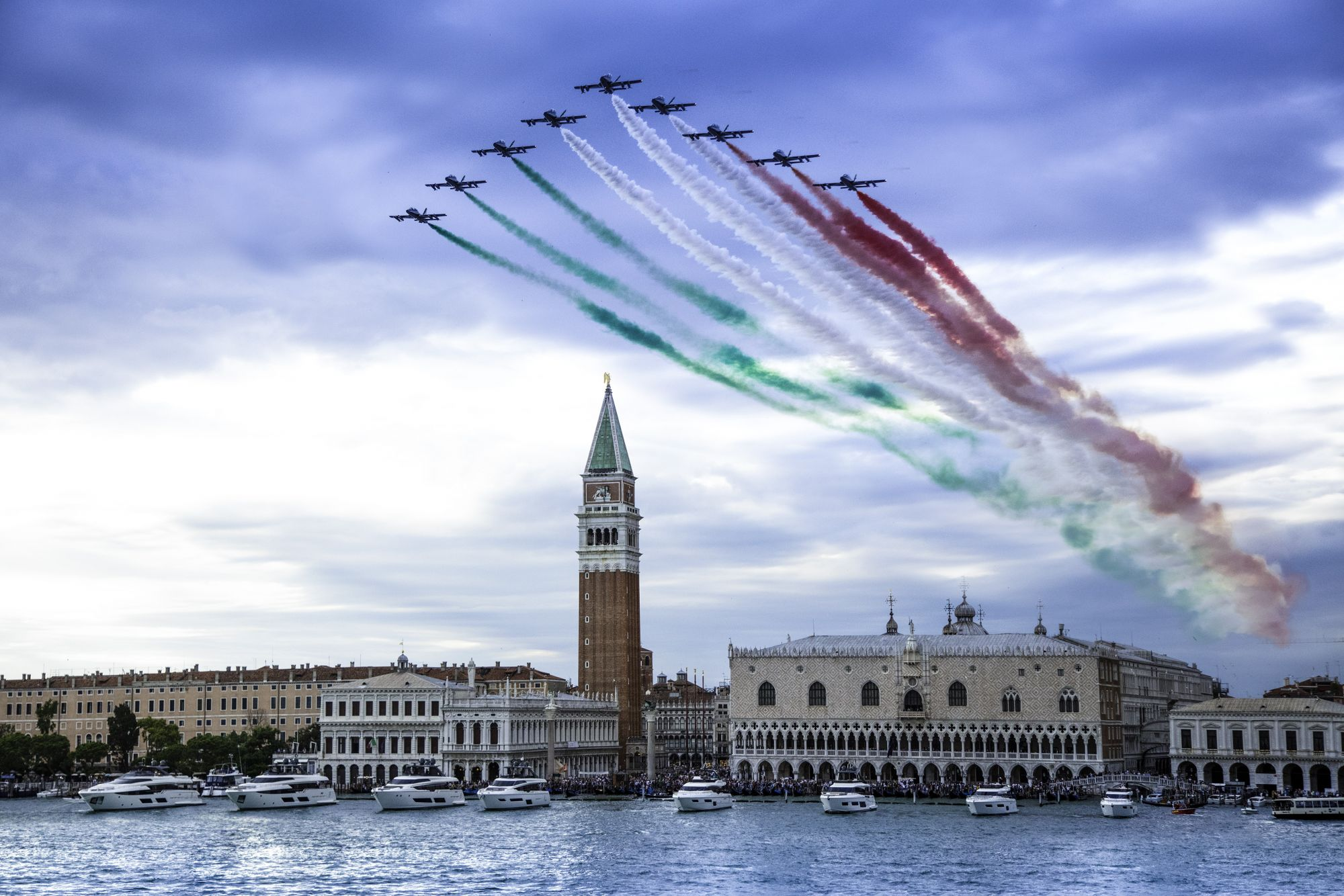 Frecce Tricolori and the Ferretti Yachts fleet parade in front of Piazza San Marco