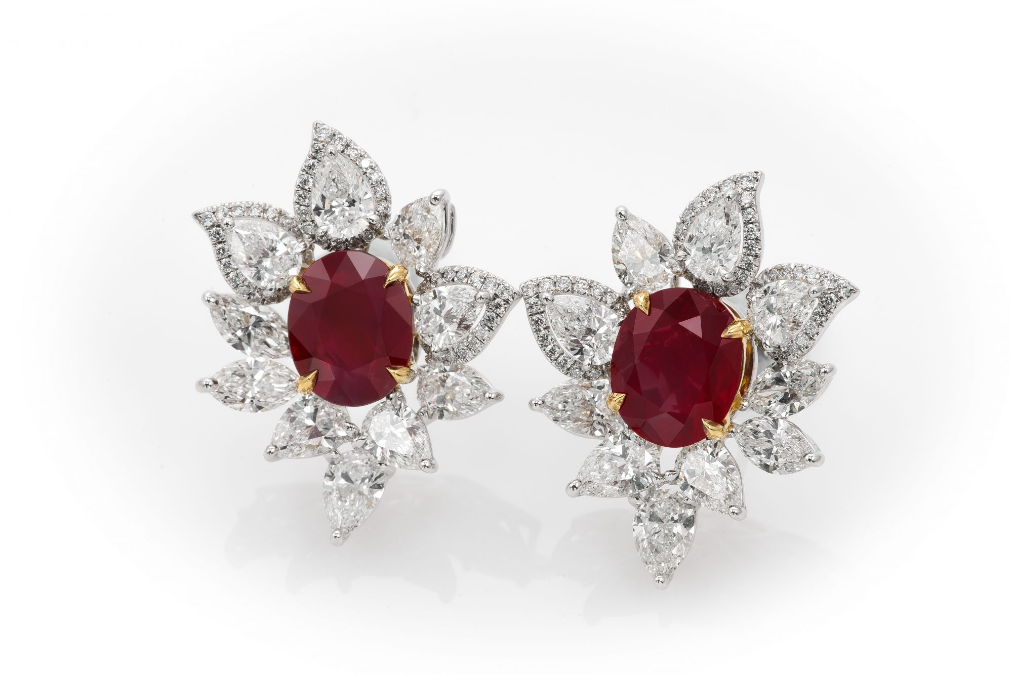 Earrings with two oval Burmese rubies totalling nearly 7ct