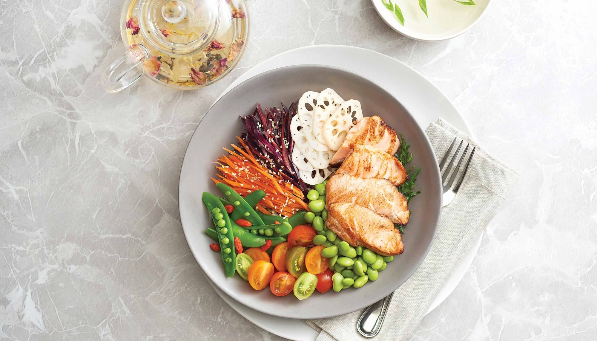 Grilled miso salmon bowl with sauteed carrots and lotus root
