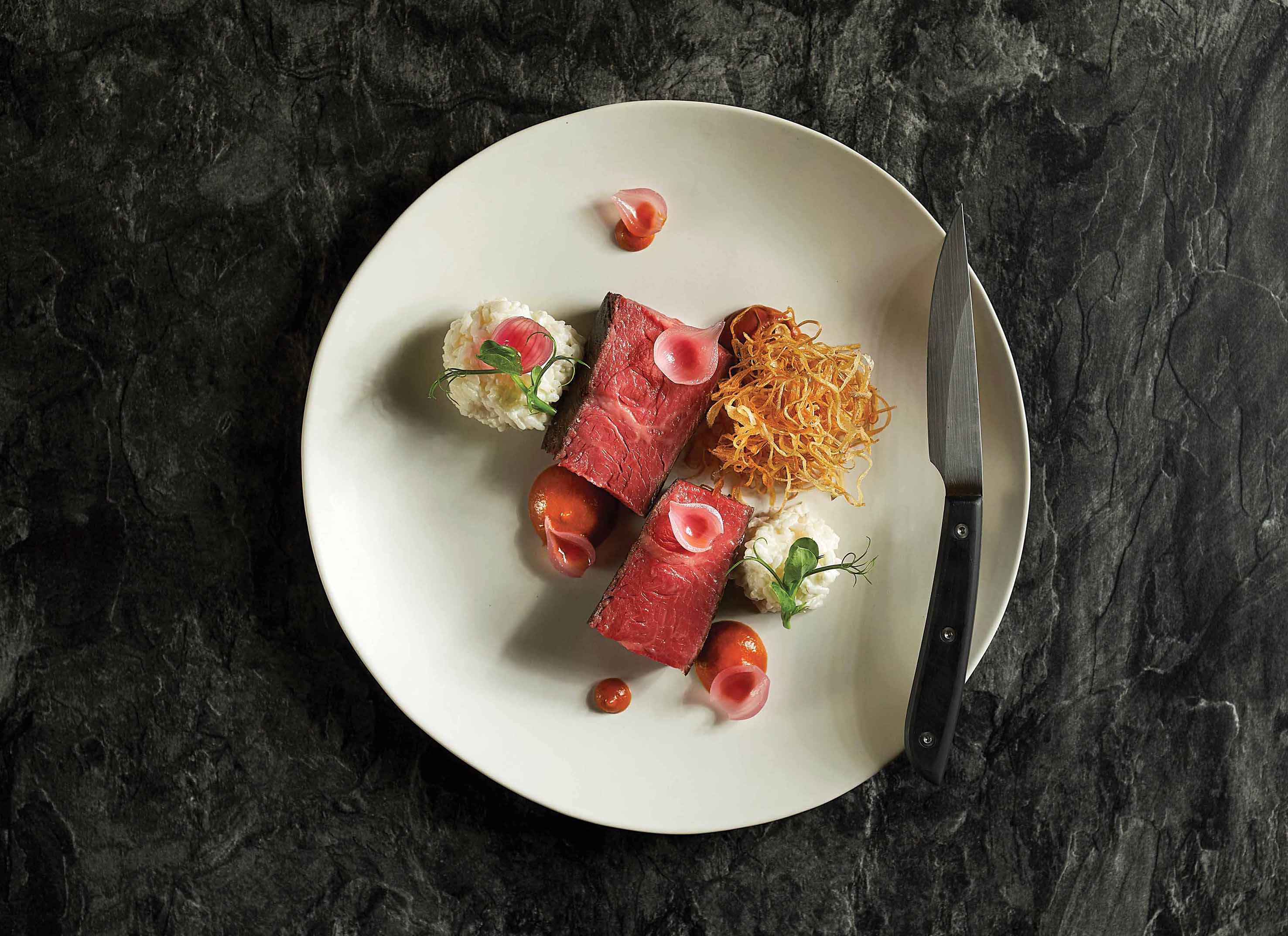 Elegant pairings of local flavours and world-class produce, such as the rendang Wagyu, are the highlights of the Dining Room menu at Straits Clan