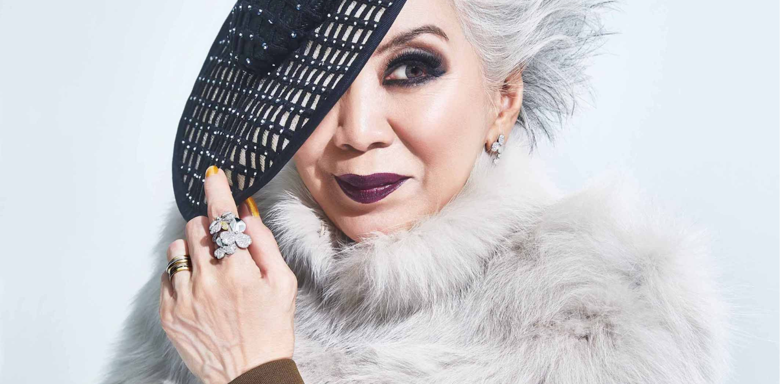 Peggy wears a Mink stole and wool jacket, both by Fendi; Tiffany Paper Flowers diamond cluster drop earrings in platinum, and yellow diamond firefly pendant and ring in platinum, all by Tiffany & Co