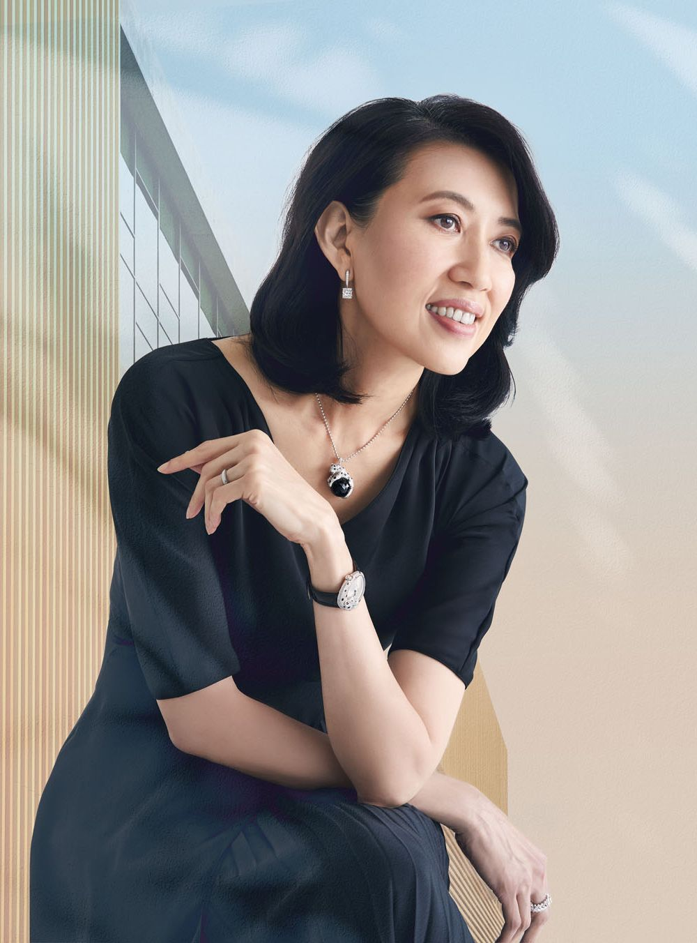 Architects CEO Angelene Chan's design for the Sunray Woodcraft Construction Headquarters won her Design of the Year at the President's Design Award in 2015.    She wears pleated silk dress by Prada; High Jewellery 1895 earrings in platinum with diamonds, Panthère de Cartier necklace in white gold with emeralds and onyx, Panthère Lovée watch in white gold with diamonds, emerald and black lacquer, and Reflection de Cartier ring in white gold with diamonds, all by Cartier