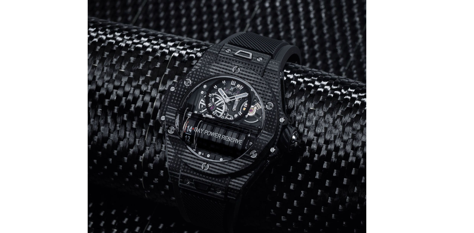 """The """"All Black"""" Big Bang MP-11 is created from a carbon polymer matrix composite reinforced by three-dimensional weave. Known as 3D carbon, it boasts a higher level of strength because it is impact-resistant from every side. The ticker is extremely light at only 90g. Hublot is the first watch brand to employ this high-tech material, which was originally used by the US Army for its military equipment"""