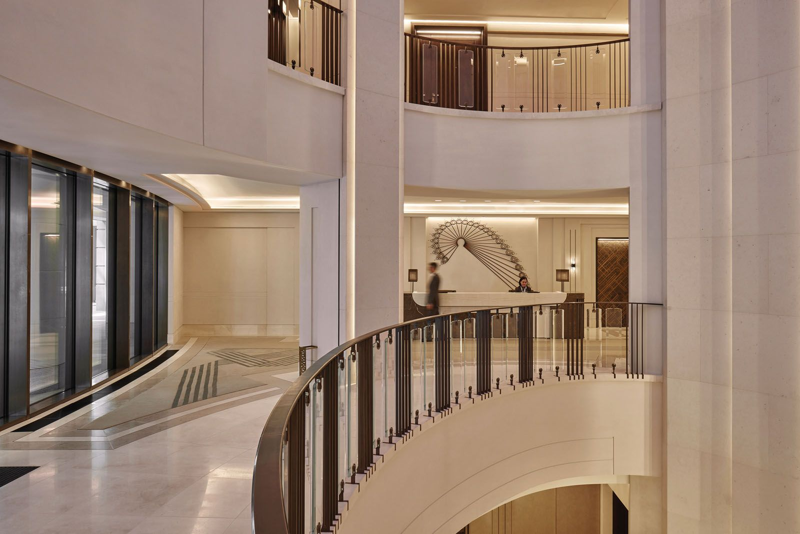 The soaring atrium provides an elegant backdrop in which to arrive