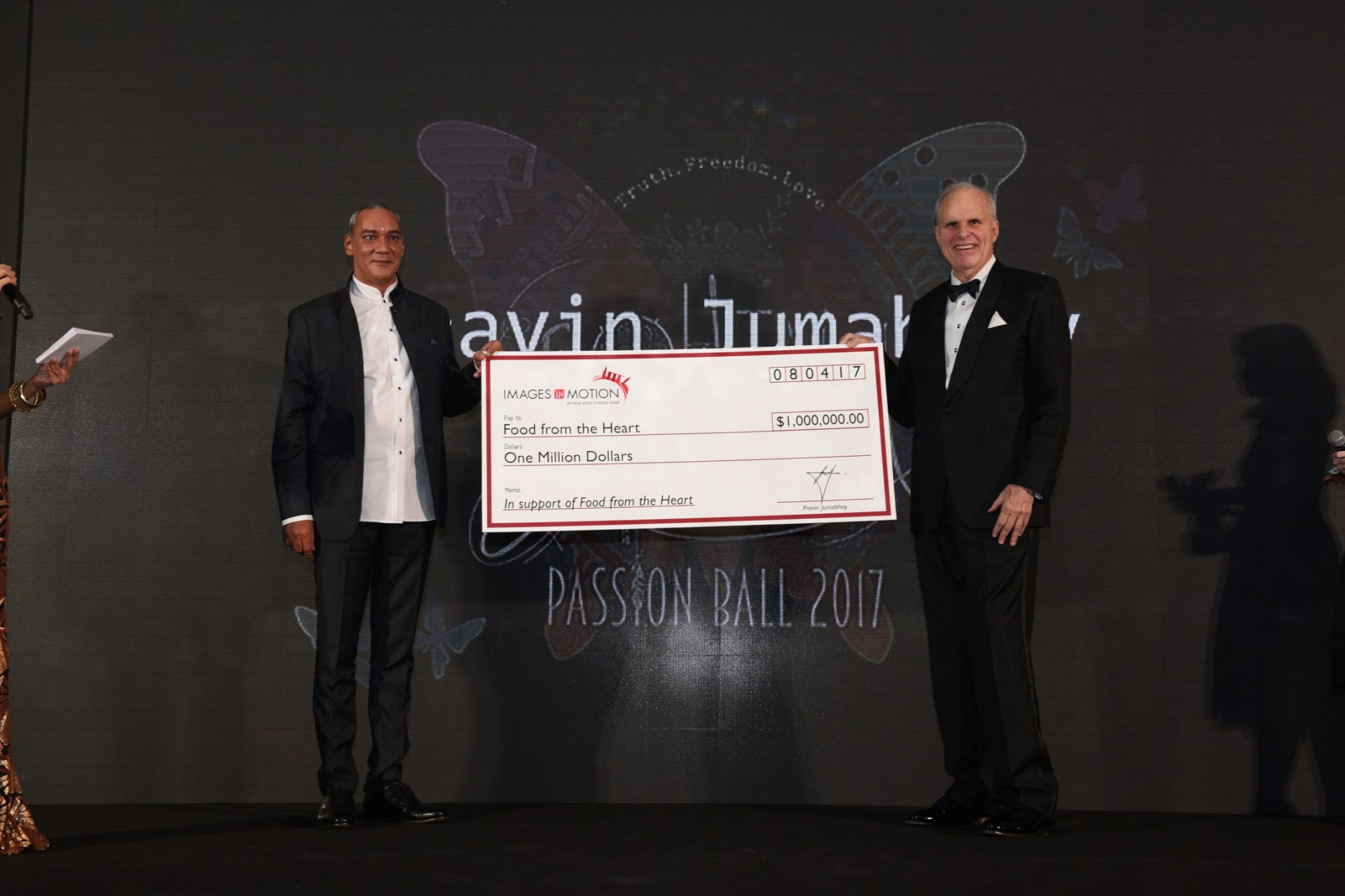 Pravin Jumabhoy, executive director of Images In Motion, presenting FFTH chairman Ronald Stride with a cheque for $1m in donation