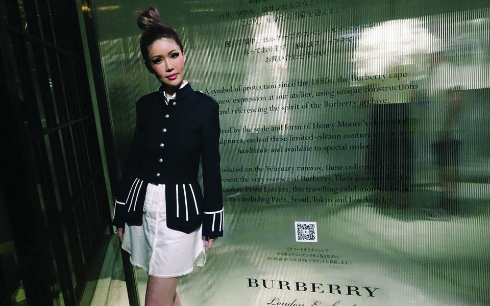 I don my monochromatic Burberry outfit, pile my hair in an insouciant top-knot, and celebrate the opening of the Burberry: The Cape Reimagined exhibition, in Omotesando, Tokyo.