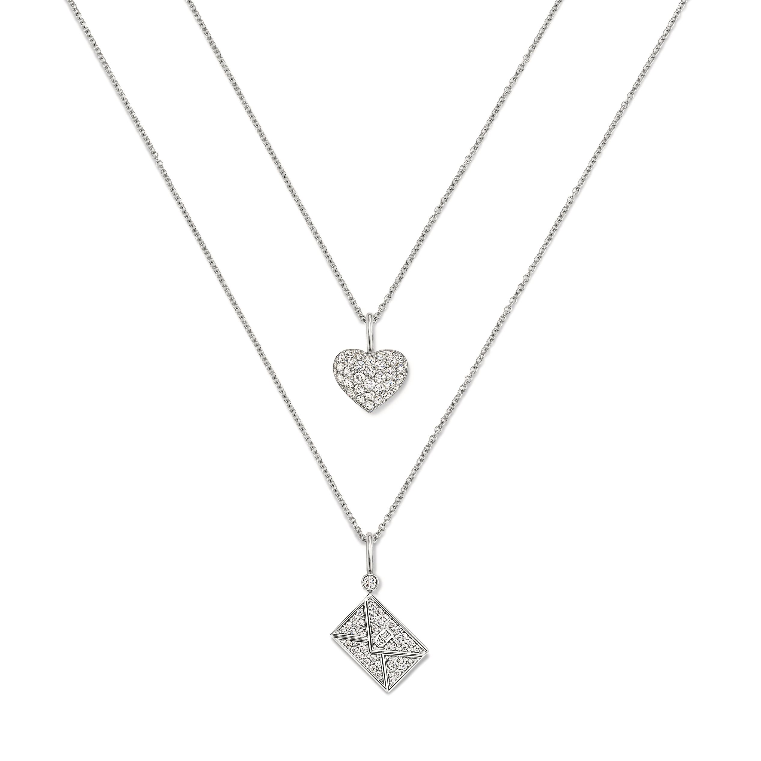 (上)Charms珠寶系列極細微密釘鑲嵌心形鑽石鉑金鍊墜(下)Harry Winston郵箋鑽石黃鉑金鍊墜 by Harry Winston。