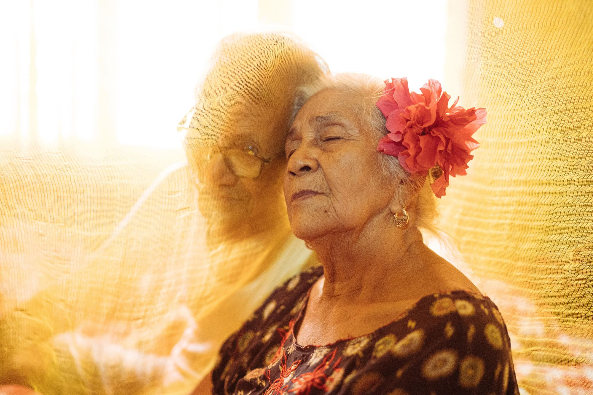 Marta poses for a photograph with her husband Apolinar in their home in Pampanga, Philippines. Martha is part of the group called 'Malaya Lolas,' or 'Free Grandmothers,' a group of survivors of mass rape during the second world war. Marta describes her husband's support as instrumental to her healing.