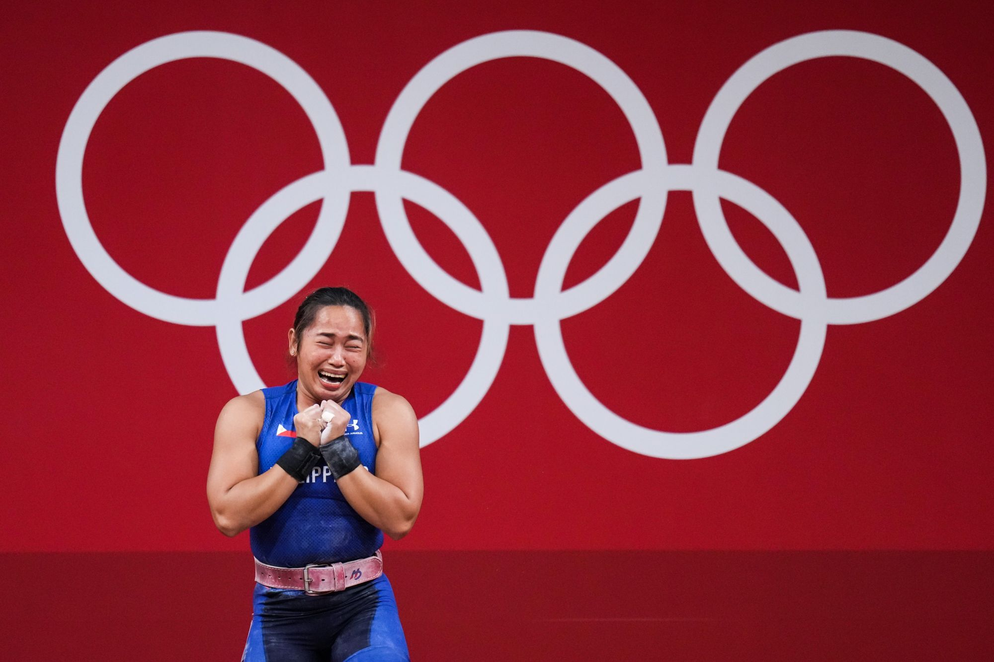 TOKYO, JAPAN - JULY 26: Hidilyn Diaz of Philippines cries after winning the Women's 55kg Weightlifting Group A match on day three of the Tokyo 2020 Olympic Games at the Tokyo International Forum on July 26, 2021 in Tokyo, Japan. (Photo by An Lingjun/CHINASPORTS/VCG via Getty Images)