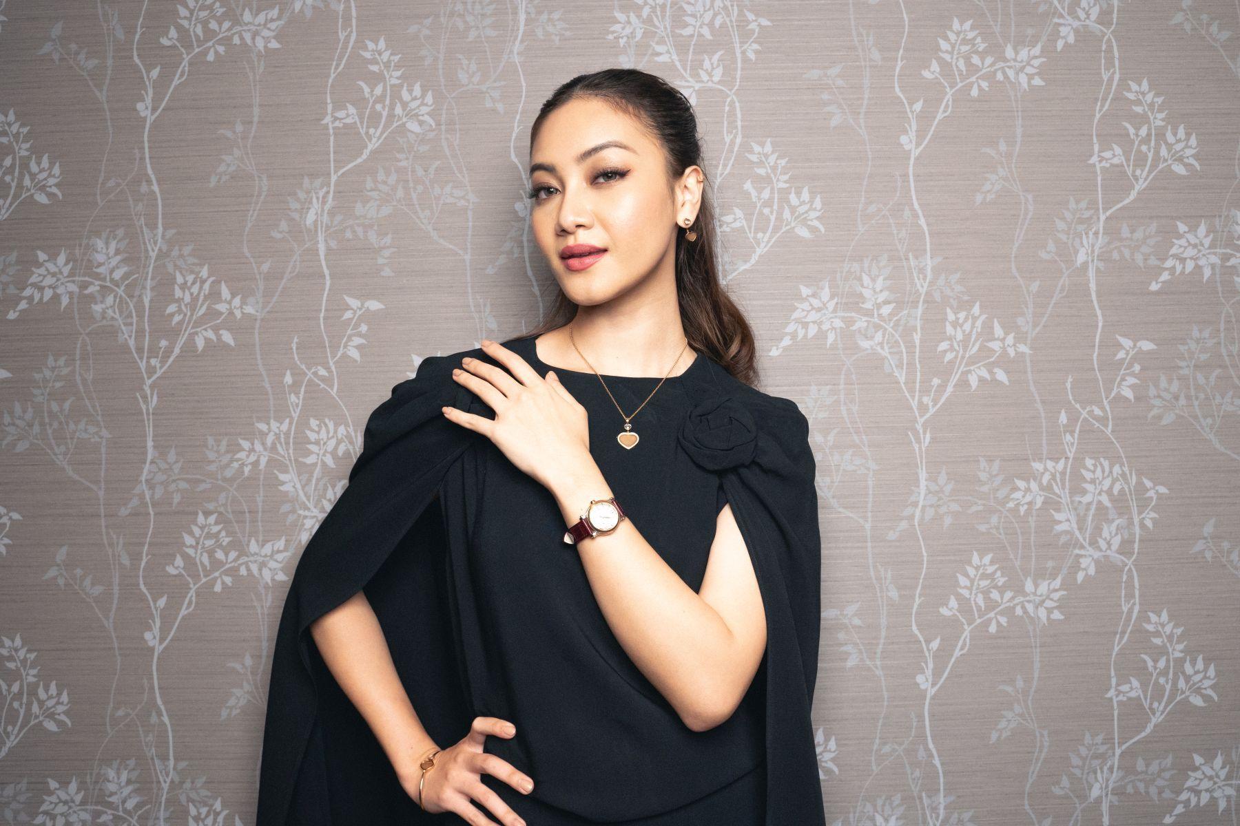 Daiyan Trisha with Chopard Happy Sport watch with dancing diamond and heart on alligator strap