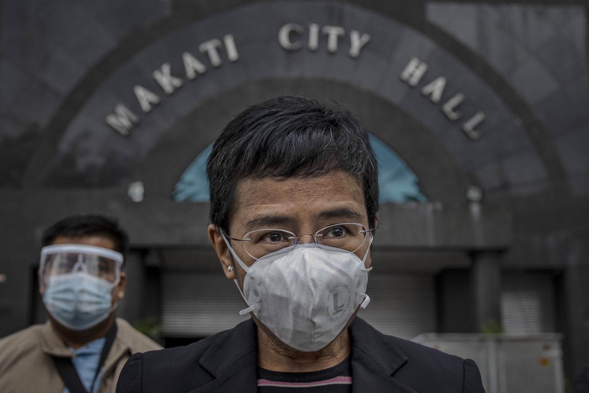 """Makati, Philippines - December 15, 2020. Maria Ressa, CEO of news website Rappler, faces reporters after appearing in court for a second """"cyber-libel"""" charge against her.  (Photo by Ezra Acayan/Getty Images)"""